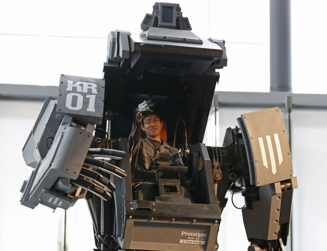 "Robotics expert Yoshizaki demonstrates how to operate the arm of a giant ""Kuratas"" robot in Tokyo"