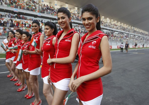 Grid girls pose before the Indian first Formula One Grand Prix at the Buddh International Circuit in Greater Noida