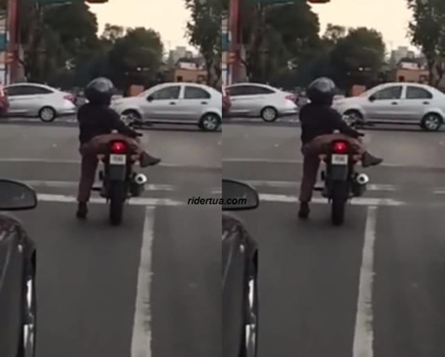 Orang pendek naik motor sport