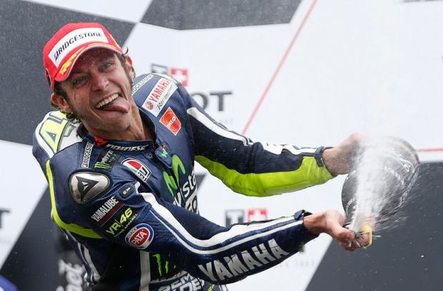 Yamaha MotoGP rider Valentino Rossi of Italy celebrates his win at the Australian Grand Prix on Phillip Island October 19, 2014. REUTERS/Jason Reed (AUSTRALIA - Tags: SPORT MOTORSPORT TPX IMAGES OF THE DAY)